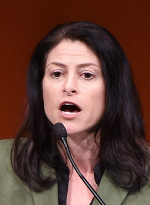 Michigan Attorney General Dana Nessel talks in a file photo of an October 2018 campaign rally.