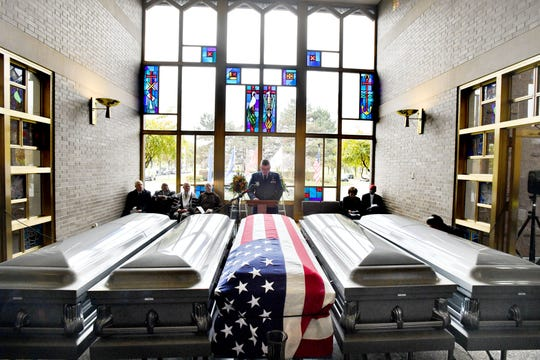About 300 unclaimed remains that were removed from Cantrell Funeral Home after the facility was closed in April were honored Friday during a service at Mt. Olivet Cemetery in Detroit.