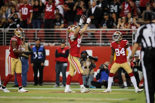 San Francisco 49ers tight end George Kittle, left, celebrates next to wide receiver Kendrick Bourne after scoring against the Oakland Raiders during the second half.