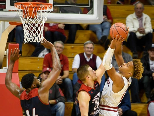 Indiana's Romeo Langford (0) shoots against defense from University of Southern Indiana's Alex Stein (20) and Emmanuel Little (14) as the University of Southern Indiana Screaming Eagles take on the Hoosiers of Indiana University in an exhibition game at Assembly Hall in Bloomington Thursday, November 1, 2018.