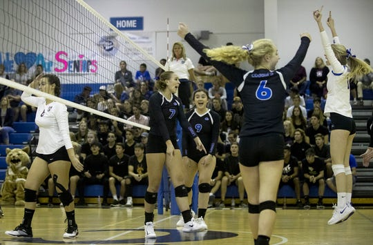 The Canterbury School volleyball players celebrate a point against First Baptist Academy during the District 3A-6 final at Canterbury in Fort Myers.