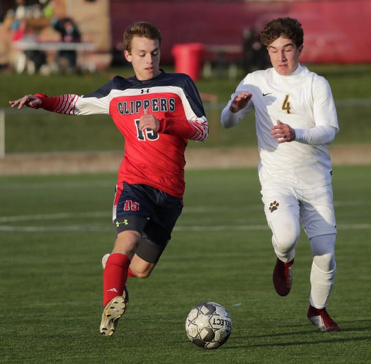 Sturgeon Bay's CJ Fairchild (15) moves upfield against University School of Milwaukee's Donovan Jones (4) during a WIAA Division 4 boys soccer state semifinal Friday at Uihlein Soccer Park in Milwaukee.