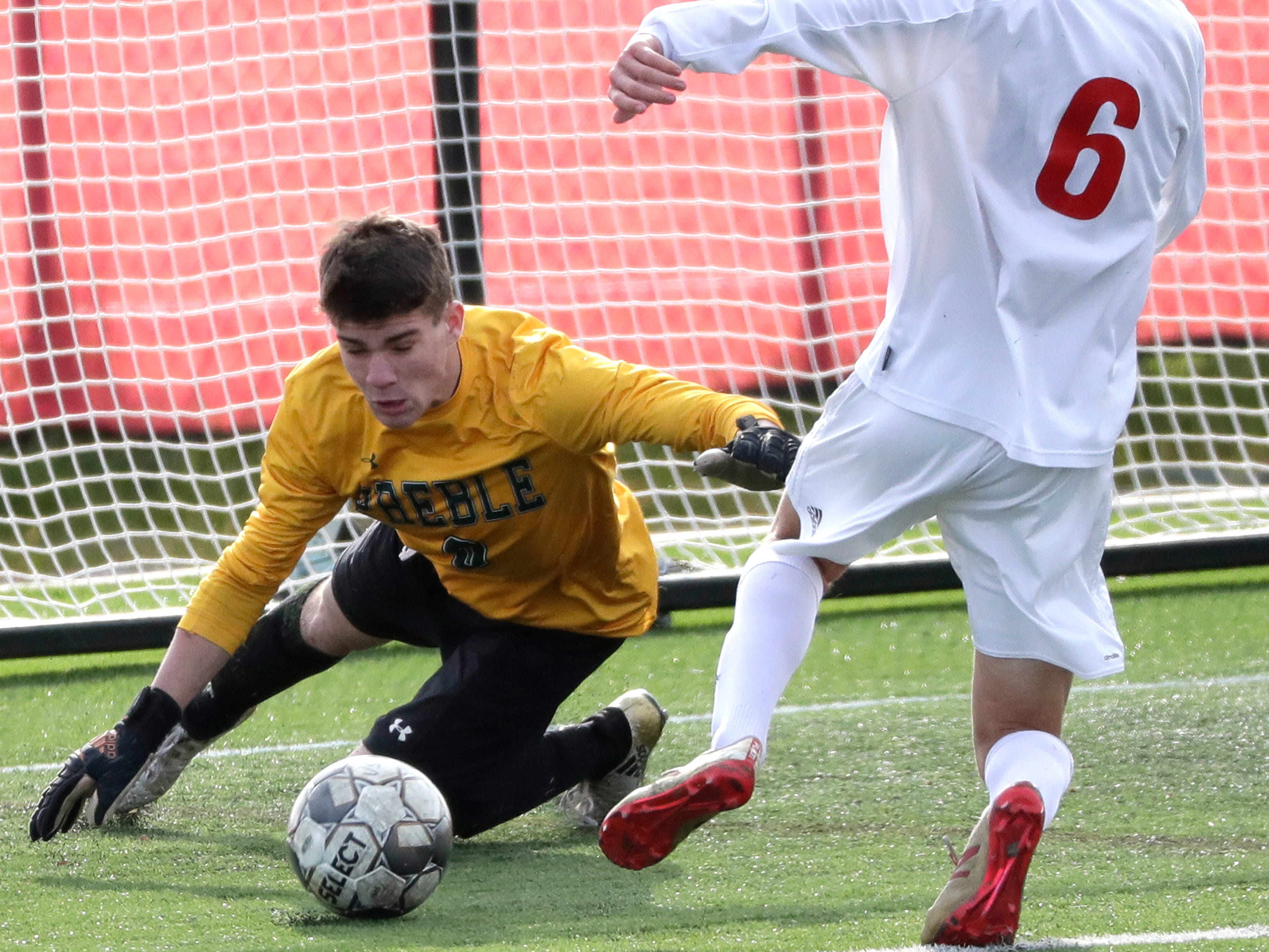 Green Bay Preble High School's goalie Noah Conard (0) prevents a shot on goal attempt against Hamilton High School's Bennett Pauls (6) during their WIAA Division 1 state semifinal boys soccer game Friday, November 2, 2018, at Uihlein Soccer Park in Milwaukee, Wis.