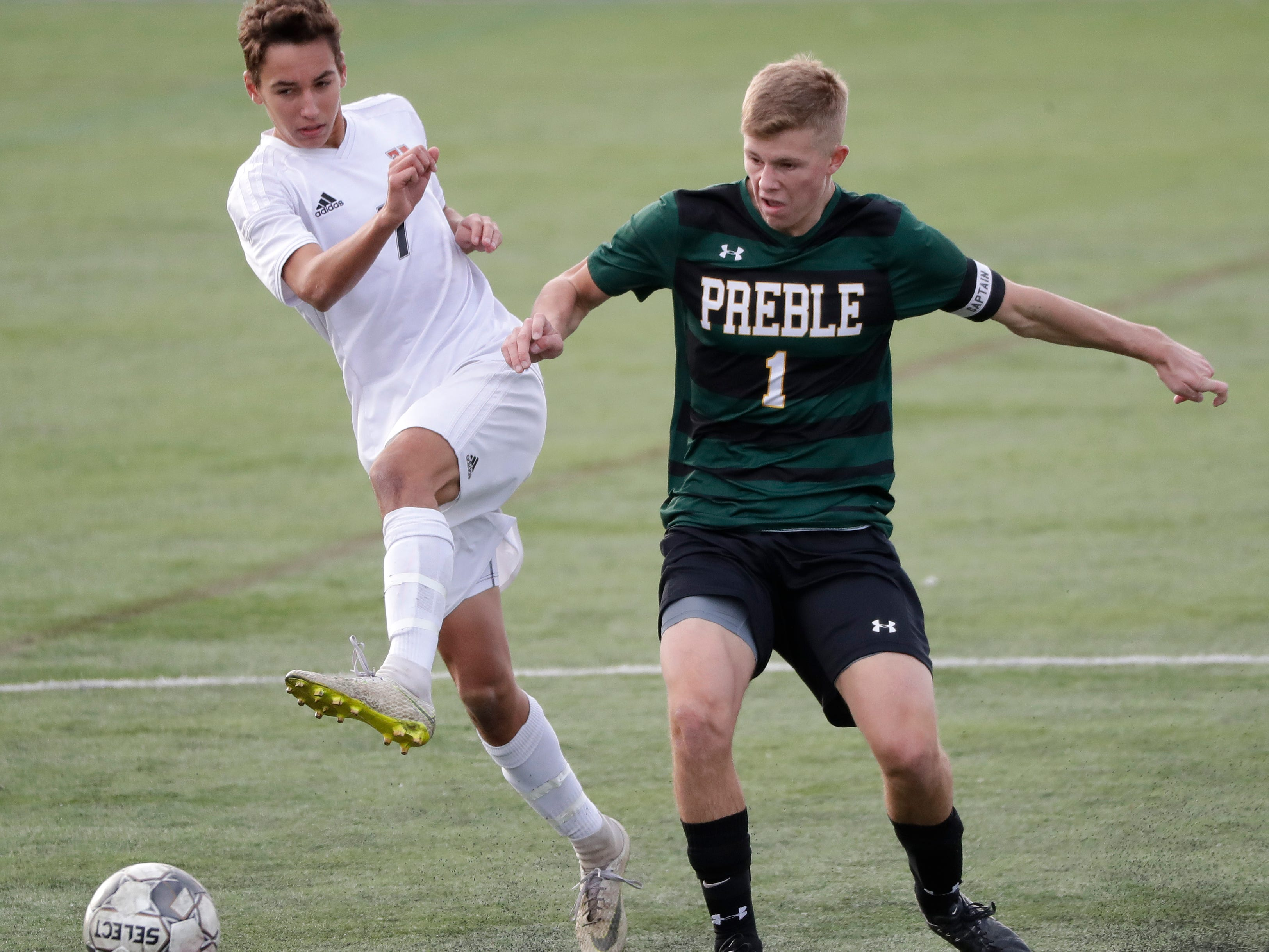 Green Bay Preble High School's Nick Hummel (1) goes up  against Hamilton High School's Trevor Millonzi (7) during their WIAA Division 1 state semifinal boys soccer game Friday, November 2, 2018, at Uihlein Soccer Park in Milwaukee, Wis.