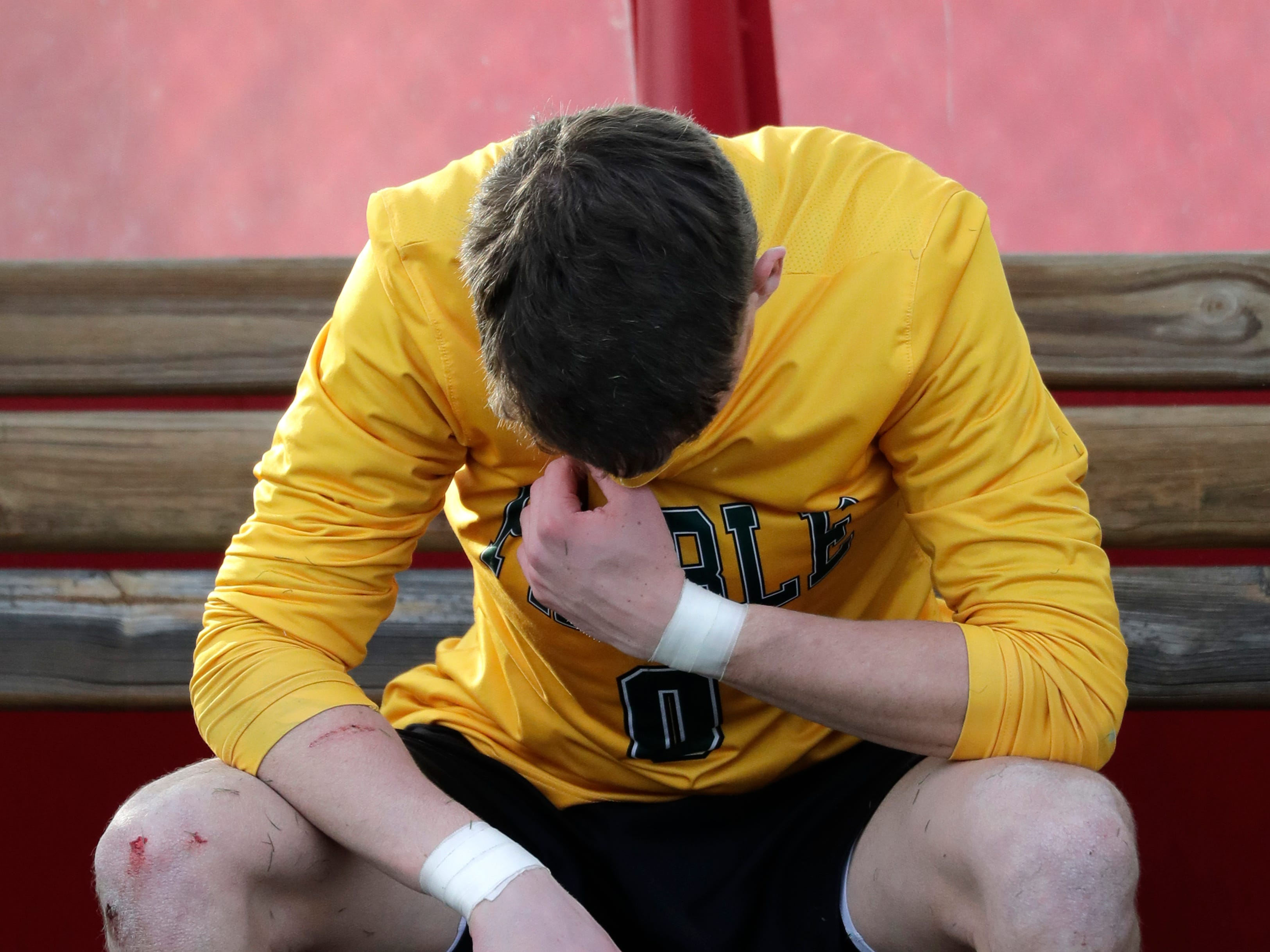 Green Bay Preble High School's goalie Noah Conard (0) takes a moment alone following a 3-0 loss against Hamilton High School during their WIAA Division 1 state semifinal boys soccer game Friday, November 2, 2018, at Uihlein Soccer Park in Milwaukee, Wis.