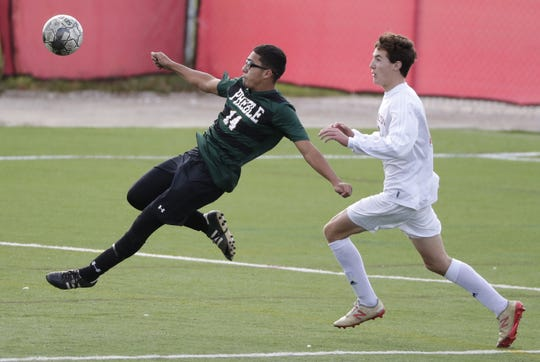Green Bay Preble's Kevin Ramos Sanchez (14) defends against Hamilton's Bennett Pauls during a WIAA Division 1 boys soccer state semifinal Friday at Uihlein Soccer Park in Milwaukee.
