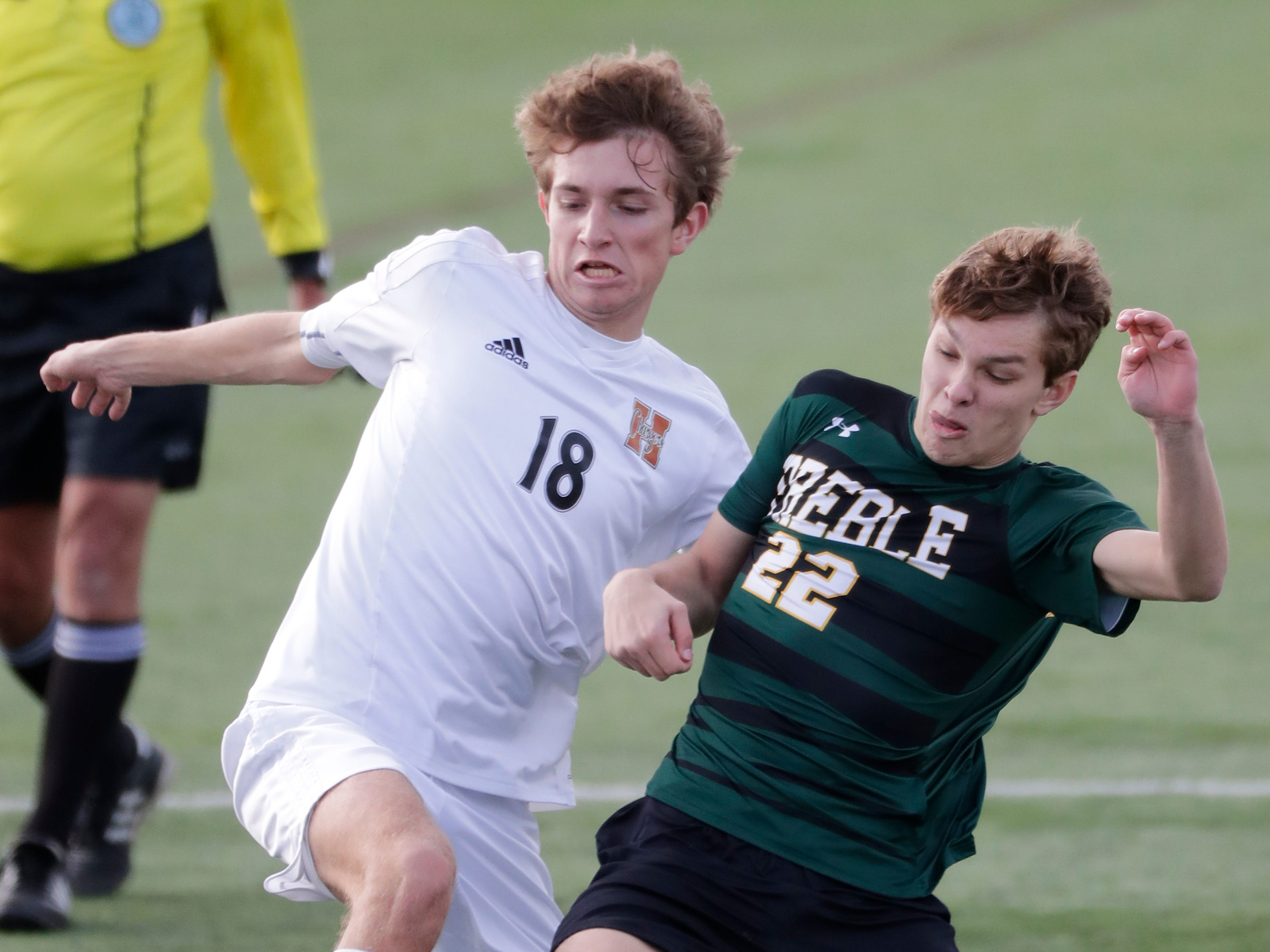 Green Bay Preble High School's Evan Vogel (22) defends against Hamilton High School's Caden Etzel (18) during their WIAA Division 1 state semifinal boys soccer game Friday, November 2, 2018, at Uihlein Soccer Park in Milwaukee, Wis.