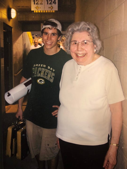 Ellen Johnson attends a Packers game at Lambeau Field in 2011 with her grandson, Brian Summerfield. It was the last game she attended and is still her favorite.