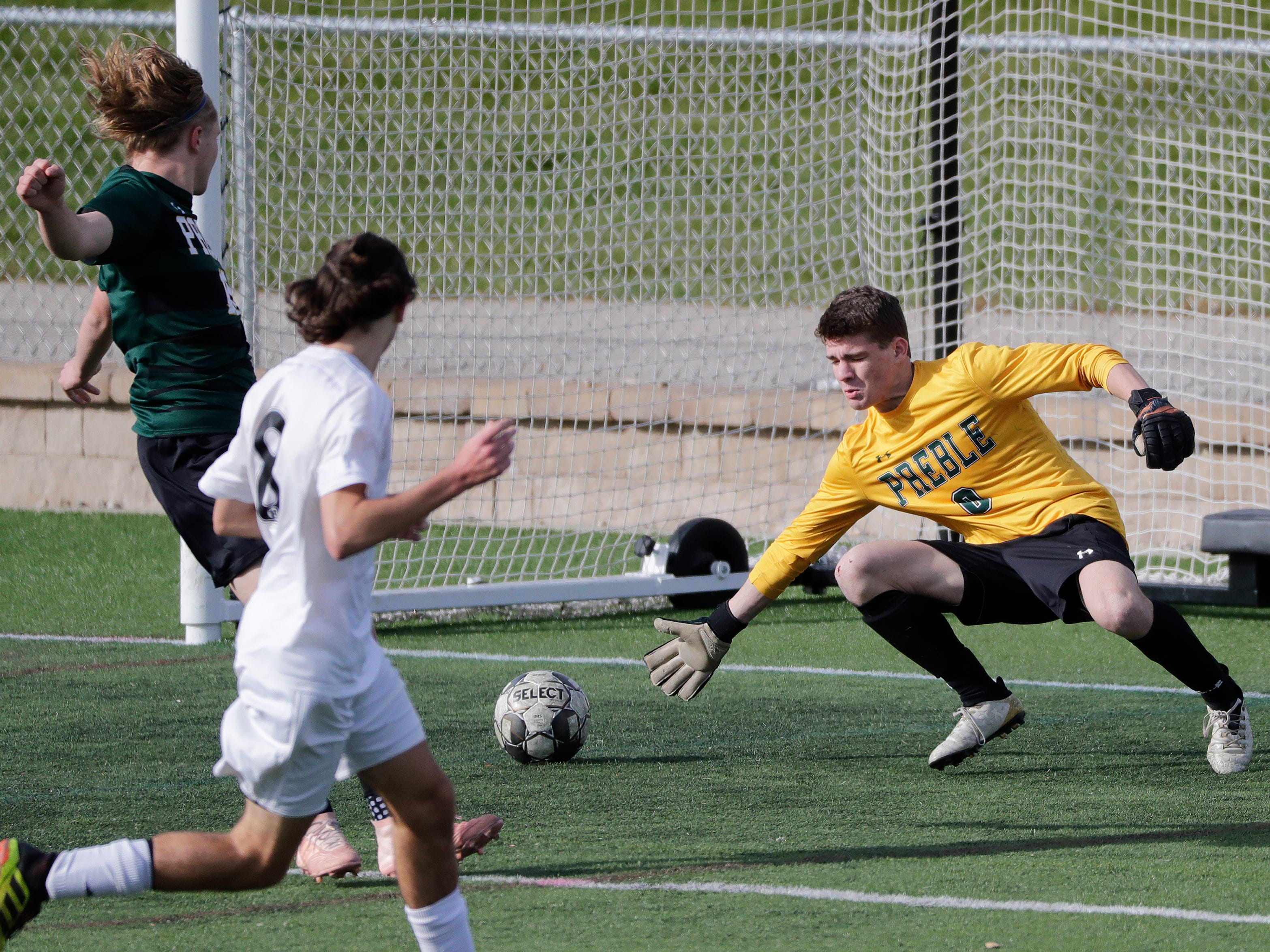 Green Bay Preble High School's goalie Noah Conard (0) is scored on by Hamilton High School's Zach Wilcox (8) in the first half during their WIAA Division 1 state semifinal boys soccer game Friday, November 2, 2018, at Uihlein Soccer Park in Milwaukee, Wis.