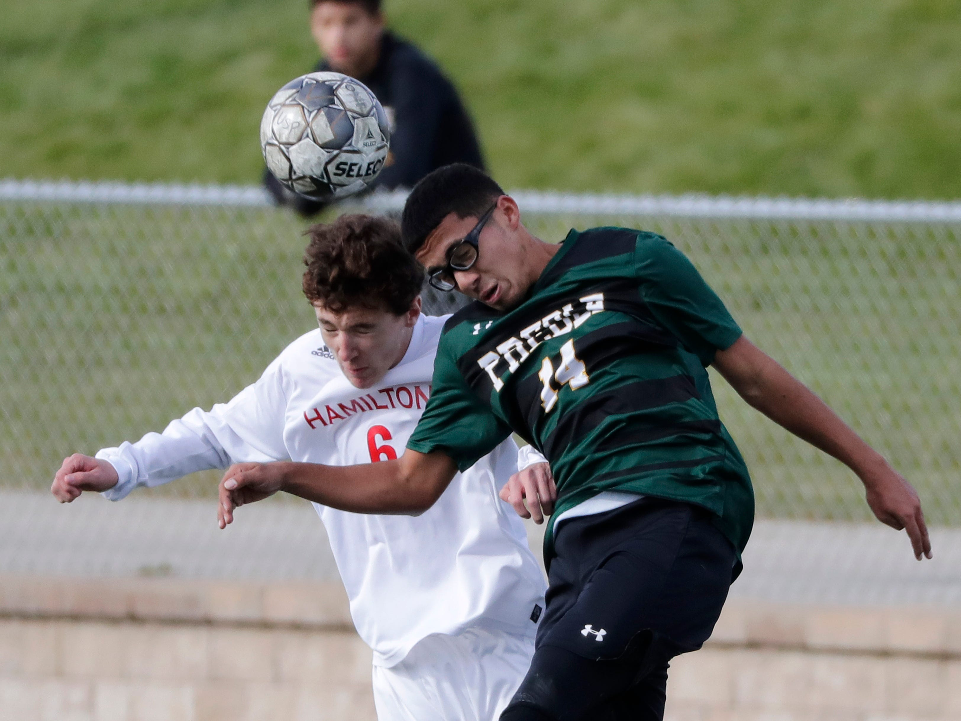 Green Bay Preble High School's Kevin Ramos Sanchez (14) defends against Hamilton High School's Bennett Pauls (6) during their WIAA Division 1 state semifinal boys soccer game Friday, November 2, 2018, at Uihlein Soccer Park in Milwaukee, Wis.