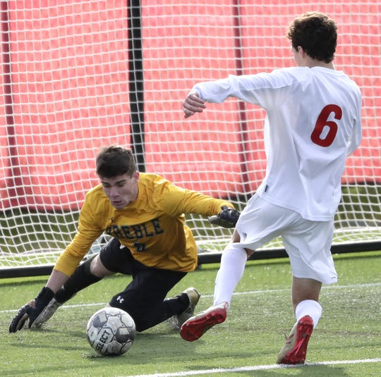 Green Bay Preble goalie Noah Conard (0) saves a shot on goal from Hamilton's Bennett Pauls during a WIAA Division 1 boys soccer state semifinal Friday at Uihlein Soccer Park in Milwaukee.