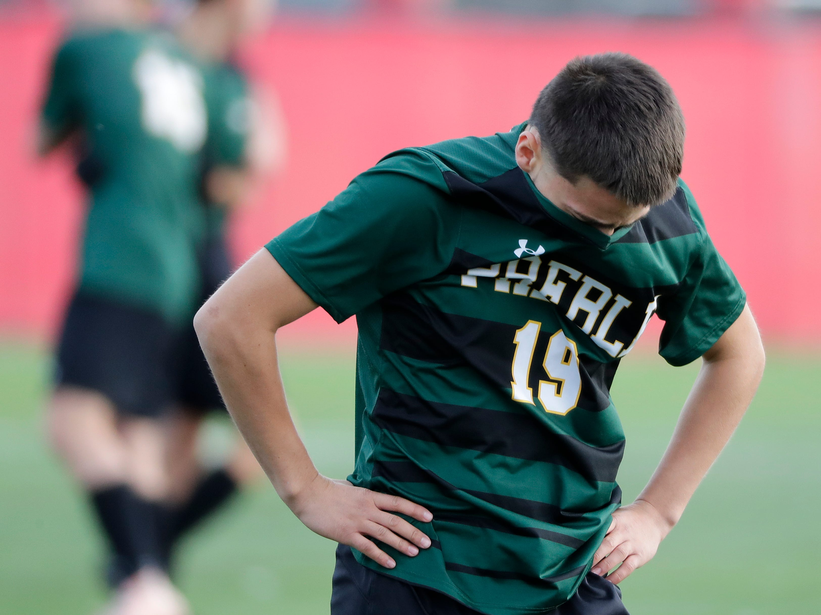 Green Bay Preble High School's Gonzalo Huete (19) hangs his head after a 3-0 loss against Hamilton High School's  during their WIAA Division 1 state semifinal boys soccer game Friday, November 2, 2018, at Uihlein Soccer Park in Milwaukee, Wis.