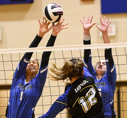 Pickens senior Sydney Bolding, left, and freshman Pickens Calie Covey (26) go up for a block against Eastside senior Madelyn Harris (12) during the second set of the Class AAAA playoffs at Pickens on Thursday, November 1, 2018.