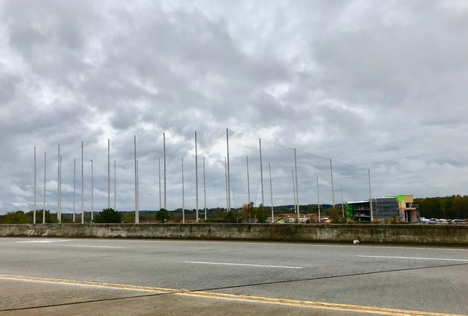 Large poles visible from Pelham Road and Interstate 85 are part of the construction of Greenville's Topgolf.
