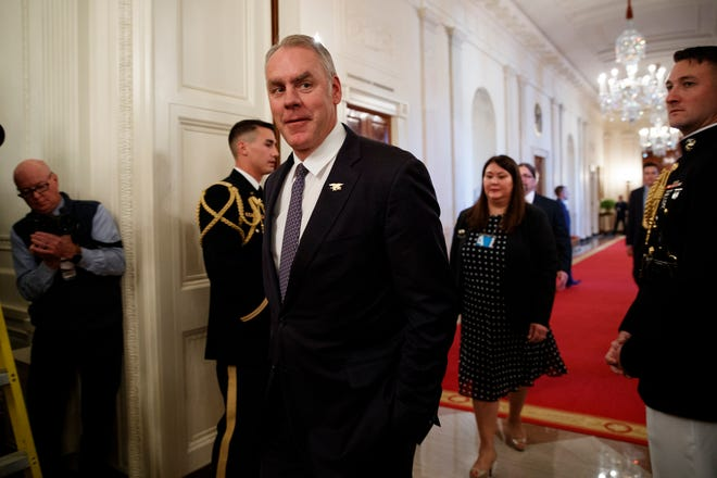 Secretary of the Interior Ryan Zinke arrives for an event with President Donald Trump on the opioid crisis, in the East Room of the White House, Wednesday, Oct. 24, 2018, in Washington. (AP Photo/Evan Vucci)
