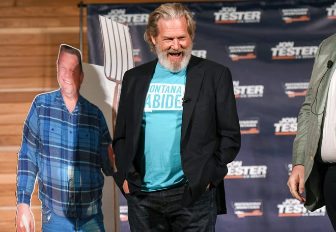 """Actor Jeff Bridges smiles during an appearance at Montana State University in Bozeman, Mont., where Bridges urged the crowd to vote for Democratic U.S. Sen. Jon Tester. The actor, known for his portrayal of a character nicknamed """"The Dude"""" in """"The Big Lebowski,"""" is arguably the biggest name to appear on Tester's behalf this election season as the candidate seeks to distance himself from the Democratic Party mainstream. (Rachel Leathe /Bozeman Daily Chronicle via AP)"""