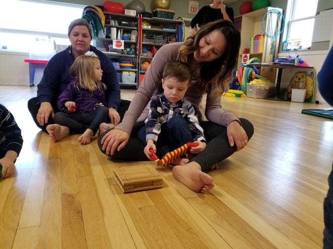 Maria Schroll and her 2-year-old son Max, right, and Sarah Goldsmith and her 3-year-old daughter Olivia take part in activities at Eagle Mount.