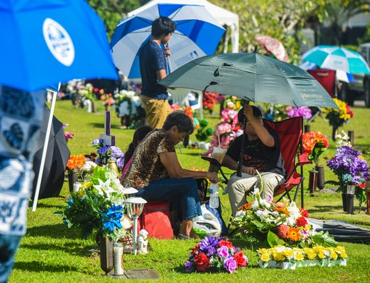 Family and friends spend time with deceased loved ones, interred at the Guam Memorial Park in Leyang, Barrigada, during All Souls' Day in this Nov. 2, 2018, file photo\.