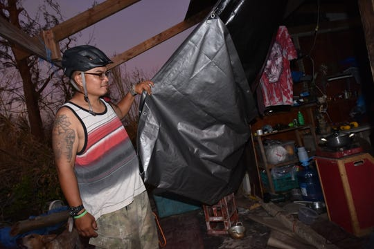 Dexter Bertulfo, 42, shows his home destroyed by Super Typhoon Yutu, in the Chalan Kanoa area of Saipan on Nov. 1, 2018. Bertulfo said he remained at his wood-and-tin home because he was worried about his pets, but evacuated around 3 a.m. of the typhoon when the roof blew away and a wood panel knocked him flat on the ground.