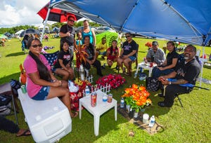 Members of the Cabrera family spend time at the gravesite of Isabel Cabrera as they celebrate All Souls' Day with others at the Guam Memorial Park in Leyang, Barrigada on Friday, Nov. 2, 2018.