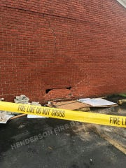 A vehicle hit the side wall of Kelsey G's Pizza in Henderson Friday morning.