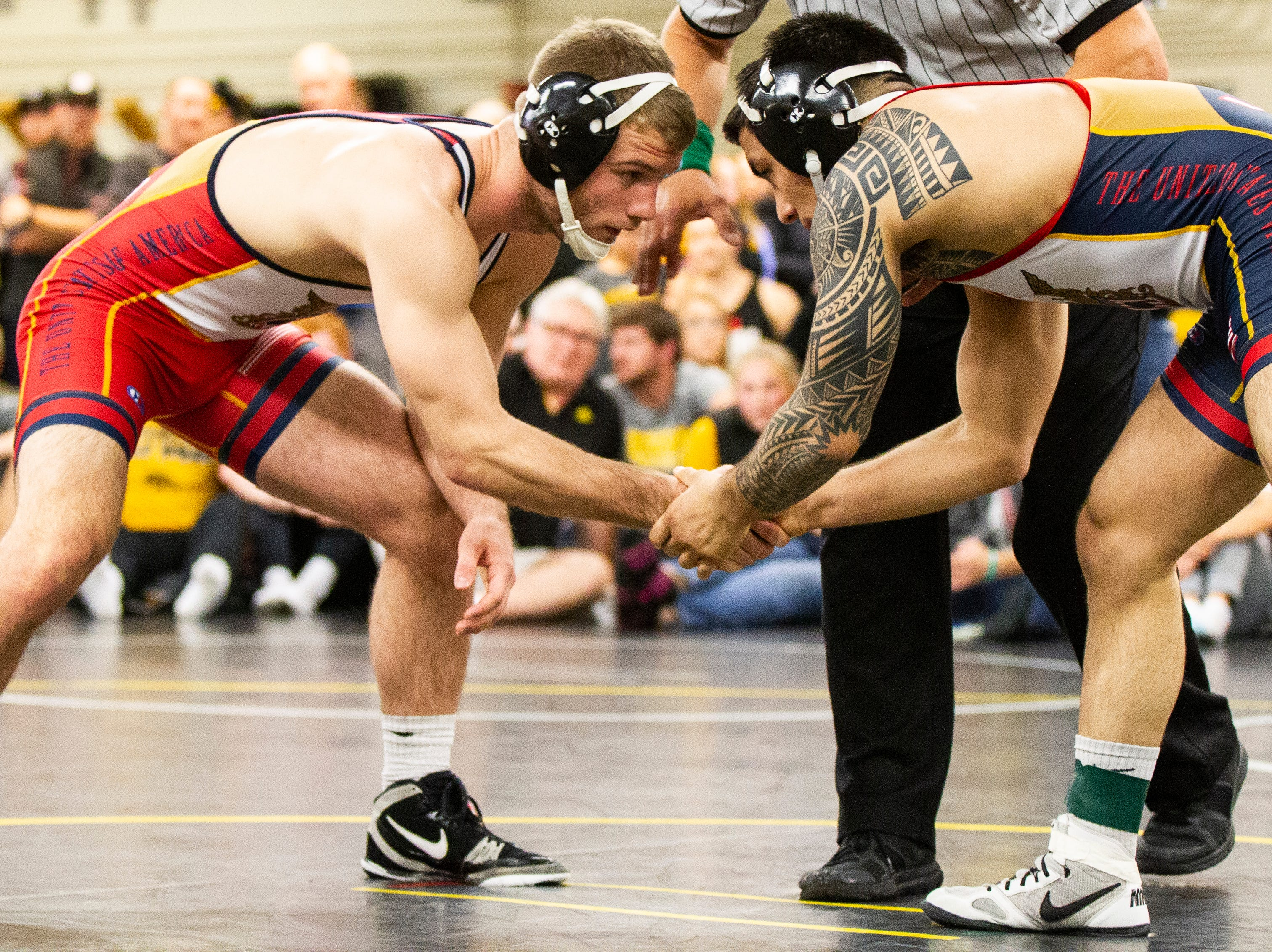 Iowa's Zach Axmear (left) shakes hands with Pat Lugo before their match at 149 during the wrestle-offs on Friday, Nov. 2, 2018, inside the Dan Gable Wrestling Complex at Carver-Hawkeye Arena in Iowa City.