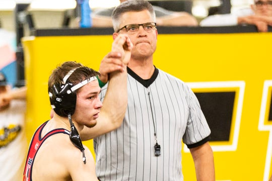 Iowa's Spencer Lee has his arm raised after winning a match at 125 during the wrestle-offs on Friday, Nov. 2, 2018, inside the Dan Gable Wrestling Complex at Carver-Hawkeye Arena in Iowa City.