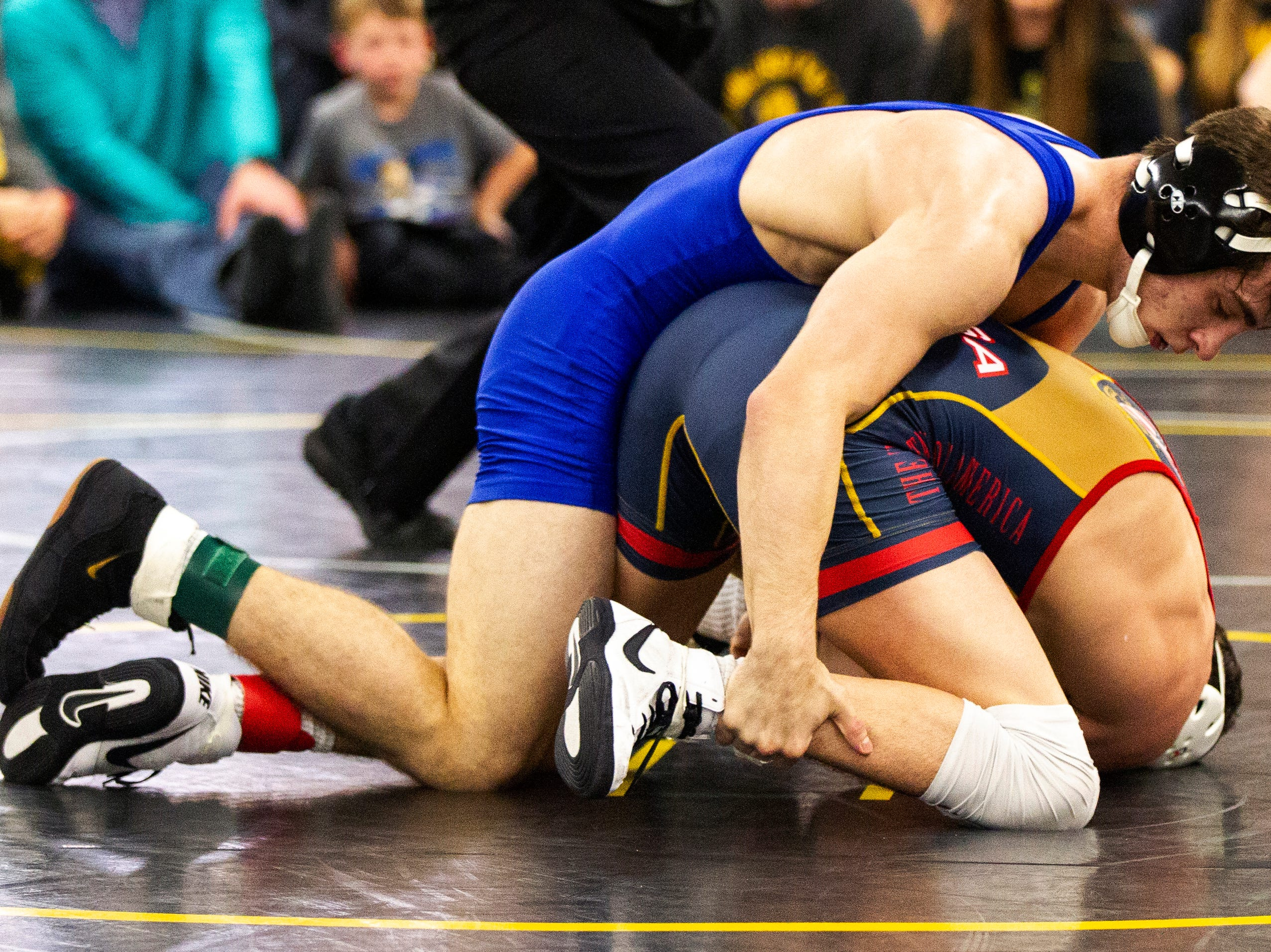 Iowa's Austin DeSanto (blue) wrestles Paul Glynn at 133 during the wrestle-offs on Friday, Nov. 2, 2018, inside the Dan Gable Wrestling Complex at Carver-Hawkeye Arena in Iowa City.