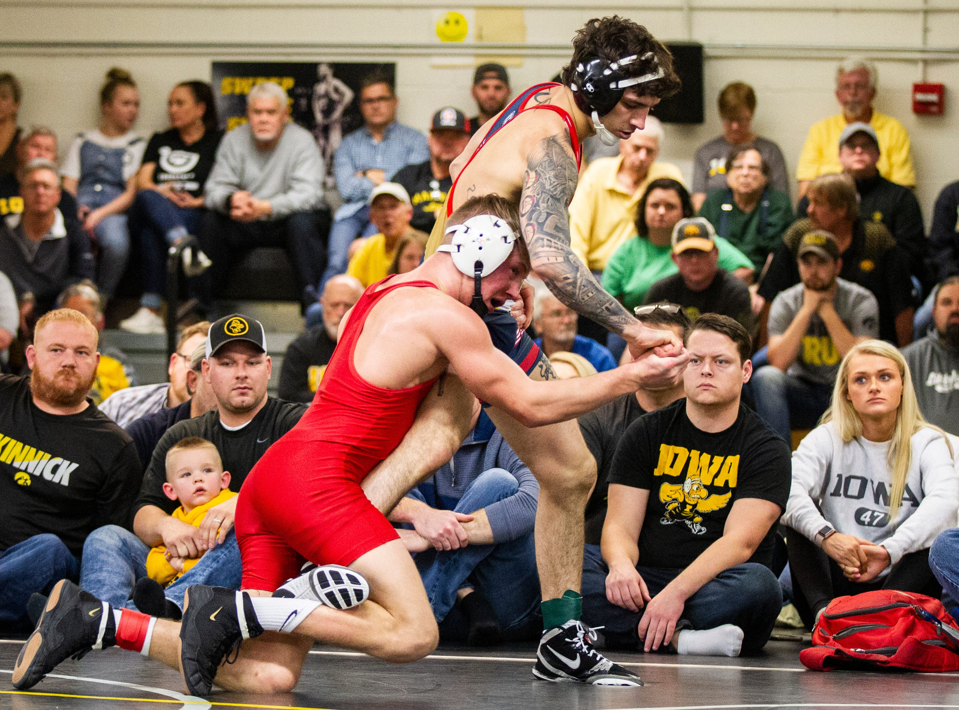 Iowa's Max Murin (left) wrestles Vince Turk at 141 during the wrestle-offs on Friday, Nov. 2, 2018, inside the Dan Gable Wrestling Complex at Carver-Hawkeye Arena in Iowa City.