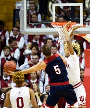 IU freshman Jake Forrester defends the rim in Thursday's exhibition game against Southern Indiana.