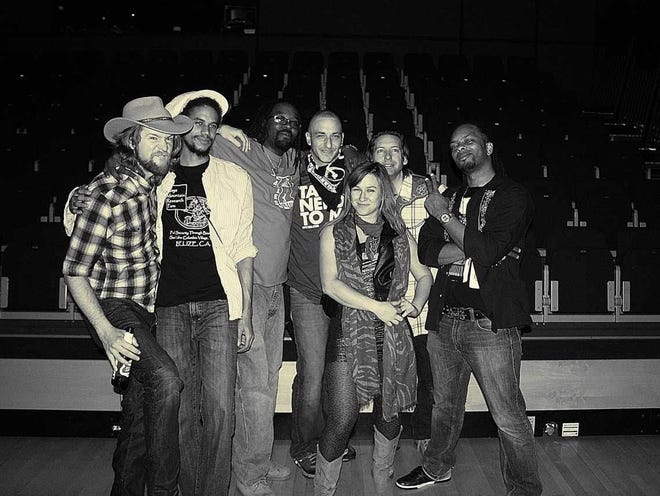 Gangstagrass fan Sean Aikins (center, wearing bandanna at his neck) poses with the band. Aikins died Oct. 27.