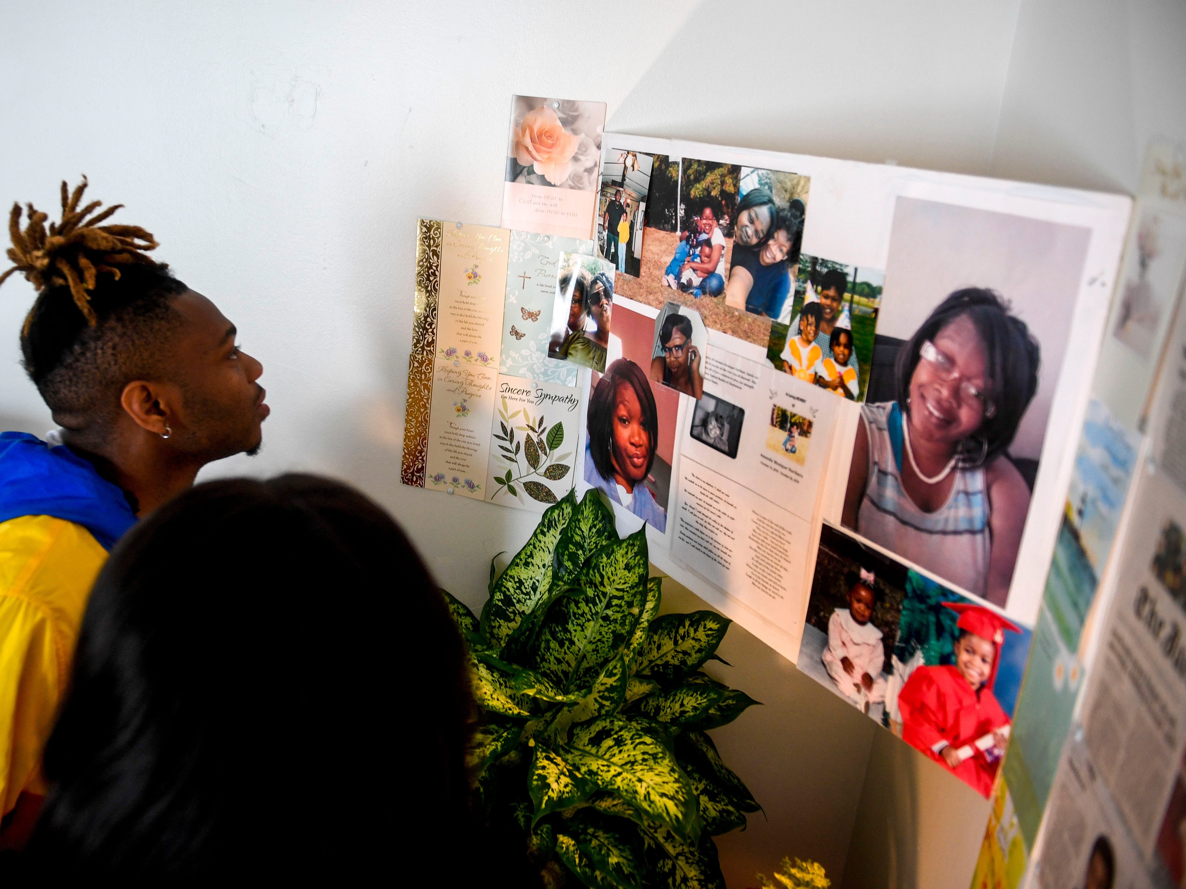 Ashley Hassell and Markel Jackson observe a memorial for Amanda Northern, a family member they lost to domestic violence at Alicia Hassell's home in Jackson, Tenn., on Friday, Nov. 2, 2018.