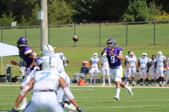 Sam Castronova (9) is the senior quarterback for Bethel University, running the offense by making the defense guess wrong in their RPO offense.