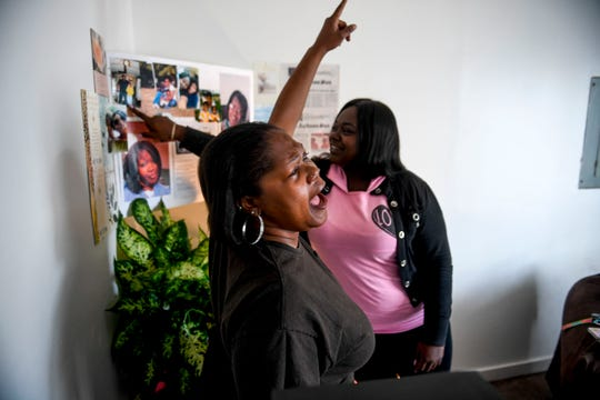"""Alicia Hassell points to the sky and screams """"She's flyin, she's up there flyin now,"""" while observing a memorial for her daughter she lost to domestic violence, Amanda Northern, at Hassell's home in Jackson, Tenn., on Friday, Nov. 2, 2018."""