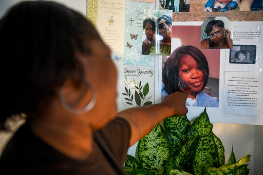 Alicia Hassell points to a photo of Amanda, the daughter she lost to domestic violence, that sits a part of a memorial at Hassell's home in Jackson, Tenn., on Friday, Nov. 2, 2018.