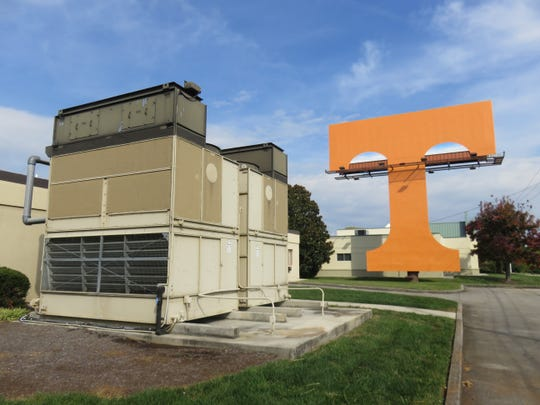 The Power T Billboard sits behind some buildings and near an air-conditioning unit off Executive Park Drive. The top of it is the size of a normal billboard.