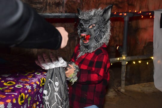 Mylan Lay, 4, takes on the cave dressed as a Werewolf at the Cherokee Caverns Trick or Treat in the Cave Sunday, Oct. 28.