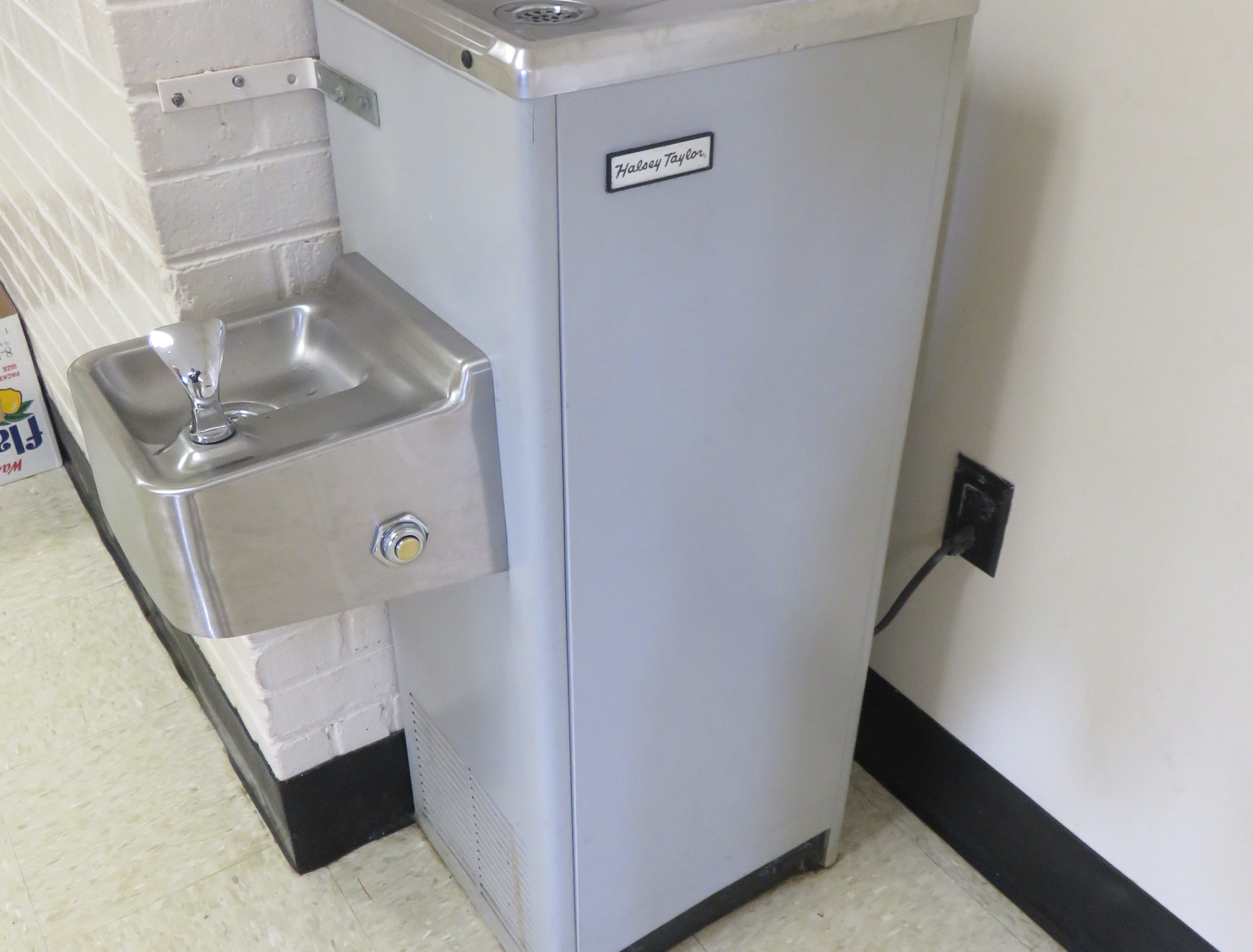 A mid-century Halsey-Taylor water fountain inside the school.