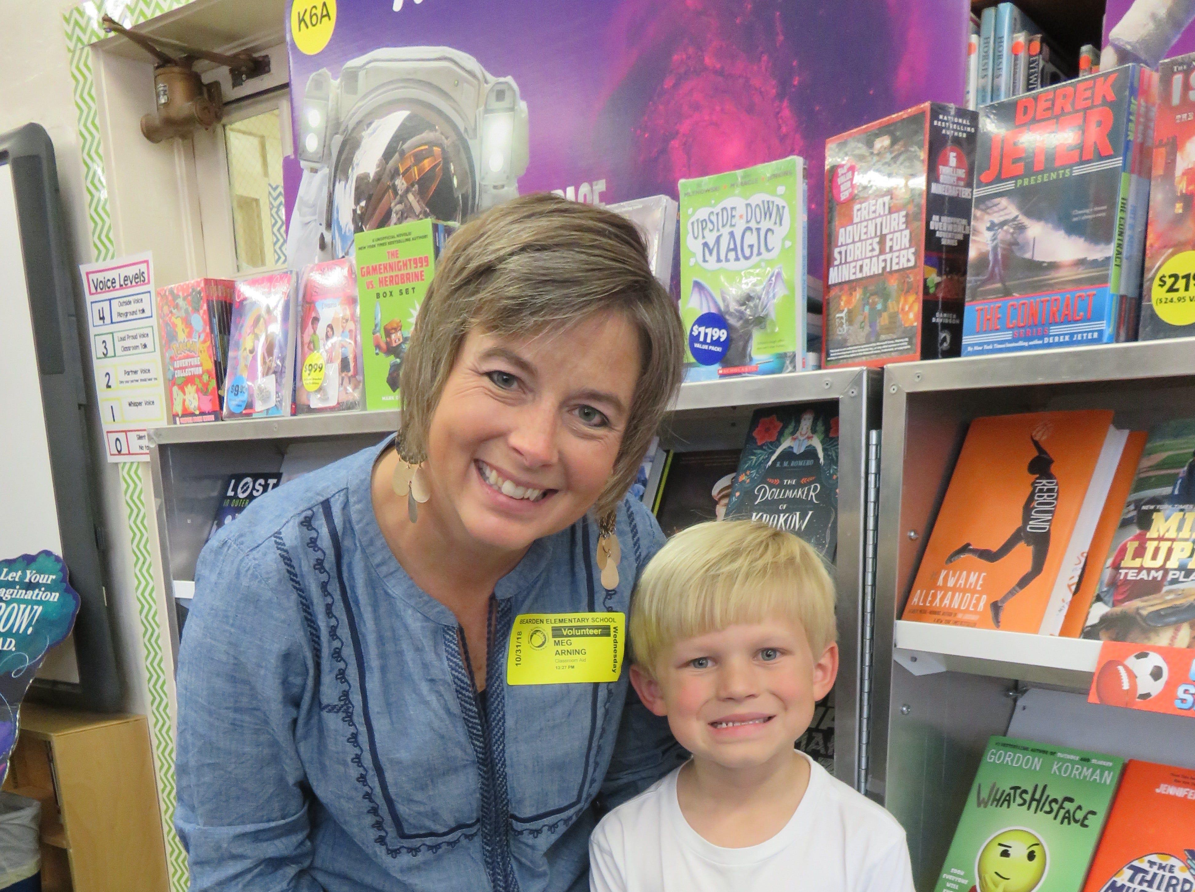 PTSO leader Meg Arning and son, Russell, at Bearden Elementary book fair