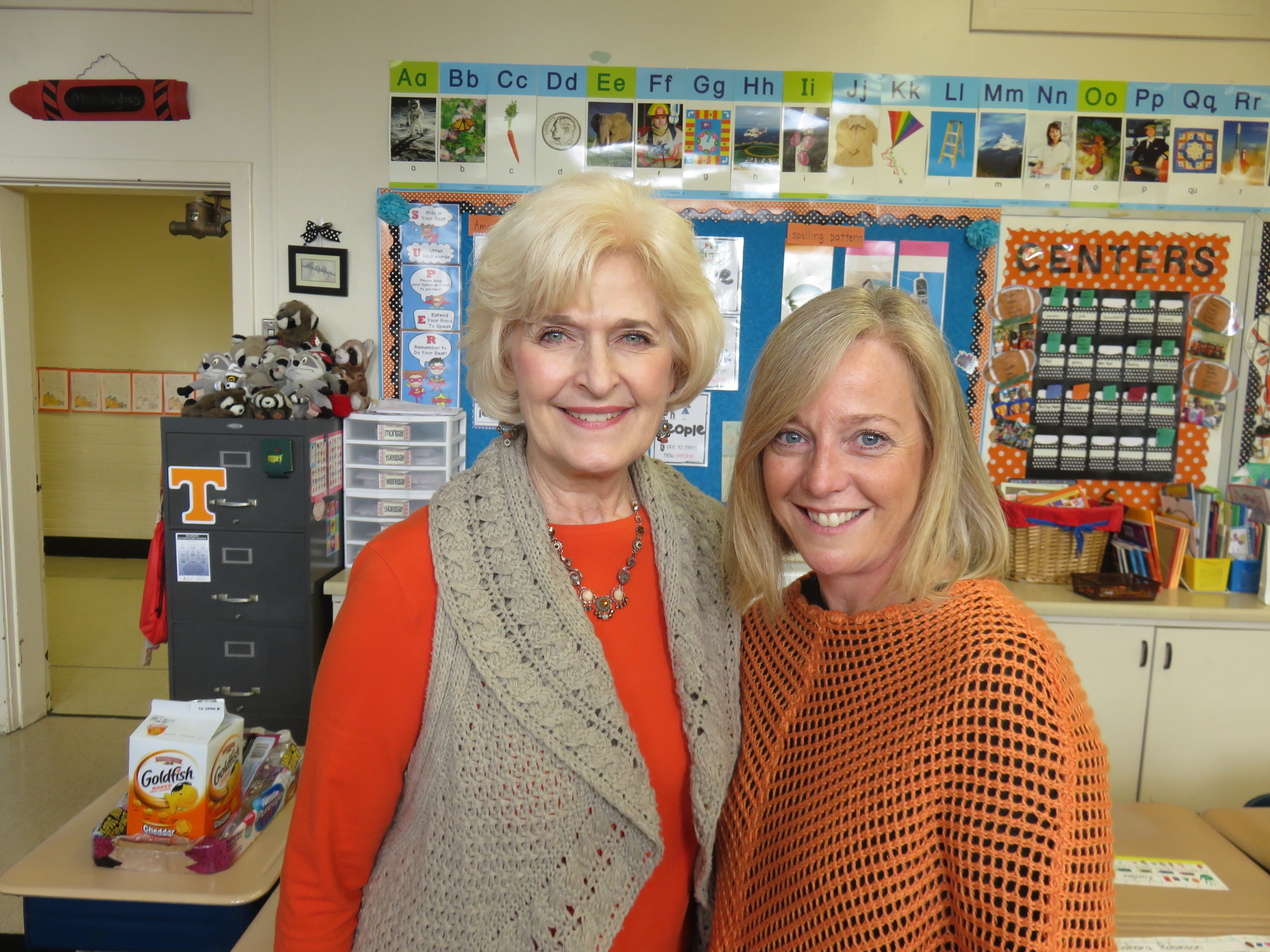 Principal Susan Dunlap, left, and first-grade teacher Ronda Hughes inside Hughes' classroom.