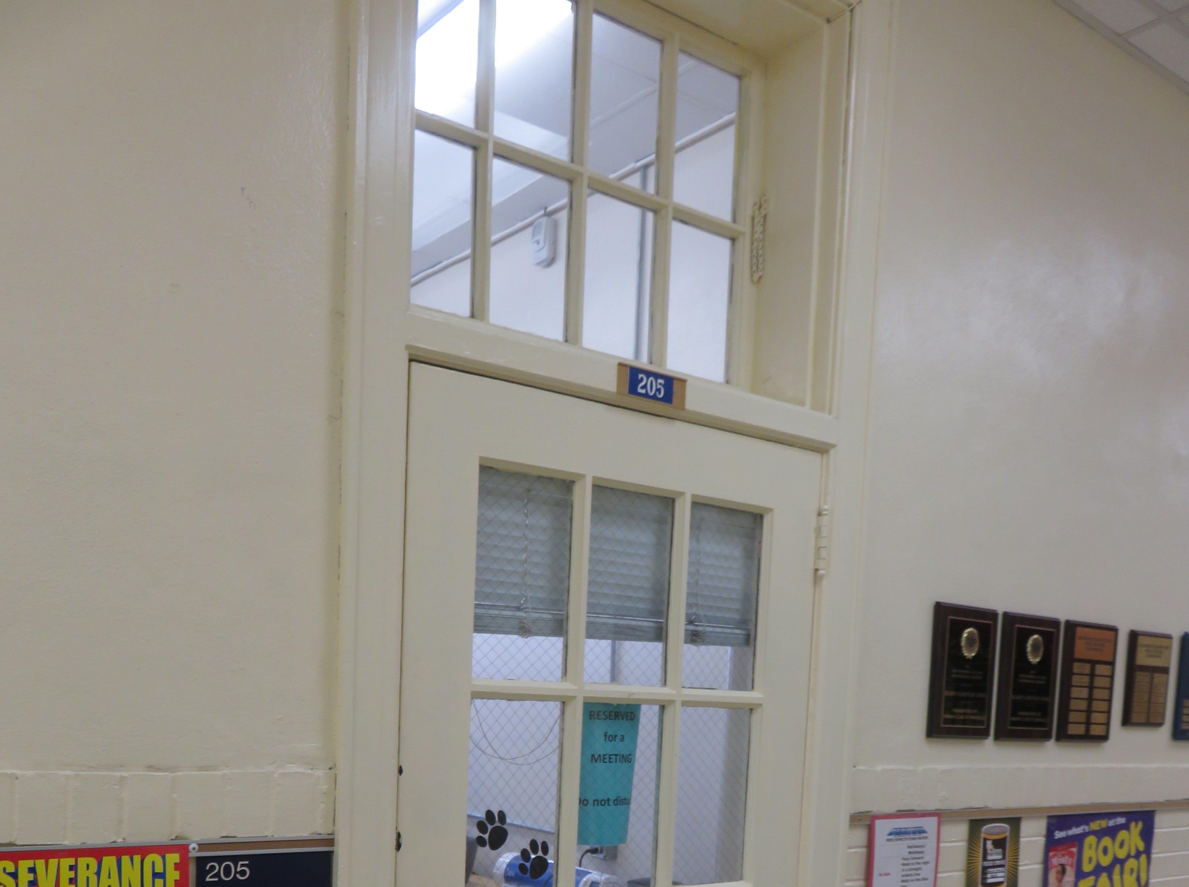 Old doors inside Bearden Elementary feature window transoms.