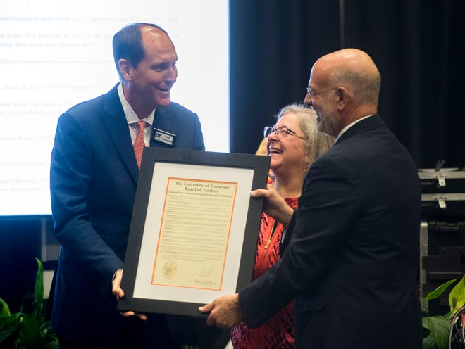University of Tennessee President Joe Pietro and wife, Deb, are presented with a resolution recognizing DiPietro's achievements during his tenure as president by the University of Tennessee Board of Trustees Chair John Compton. He was given the resolution in the first meeting for the new board — and DiPietro's last meeting as President — on Friday.