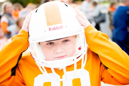 "Cole Rouse, of Corinth, Mississippi, adjusts his helmet before the annual University of Tennessee Homecoming Parade in Knoxville, Tennessee on Friday, November 2, 2018. This year's homecoming theme was ""Sweet as Soda Pop!"""