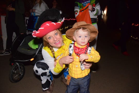 Kelly Tugman with Elijah Tugman, 1, as Woody from Toy Story at the Cherokee Caverns Trick or Treat in the Cave Sunday, Oct. 28.