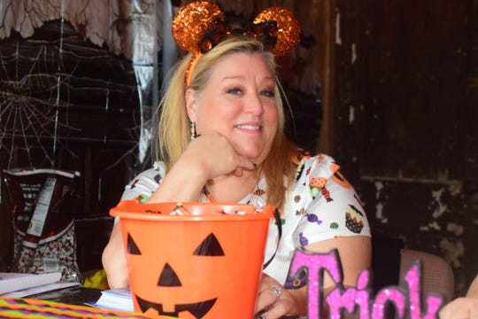 Caver conservationist Dana Whidby smiles in the ticket booth at the Cherokee Caverns Trick or Treat in the Cave on Sunday, Oct. 28.