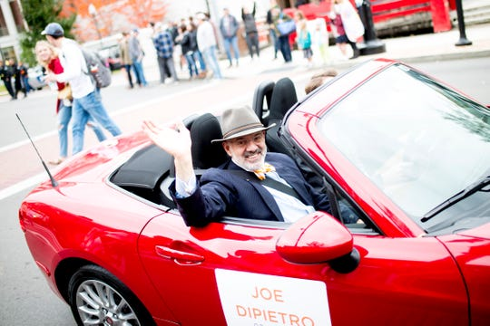 """Outgoing University of Tennessee President Joe DiPietro waves to the crowd on Cumberland Ave. during the annual University of Tennessee Homecoming Parade in Knoxville, Tennessee on Friday, November 2, 2018. This year's homecoming theme was """"Sweet as Soda Pop!"""""""
