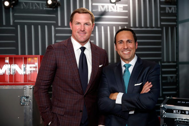 In this Thursday, Aug. 16, 2018, file photo, former NFL player and now analyst Jason Witten, left, and play-by-play commentator Joe Tessitore pose for a photograph before their ESPN telecast of a preseason NFL football game between the Washington Redskins and the New York Jets in Landover, Md.