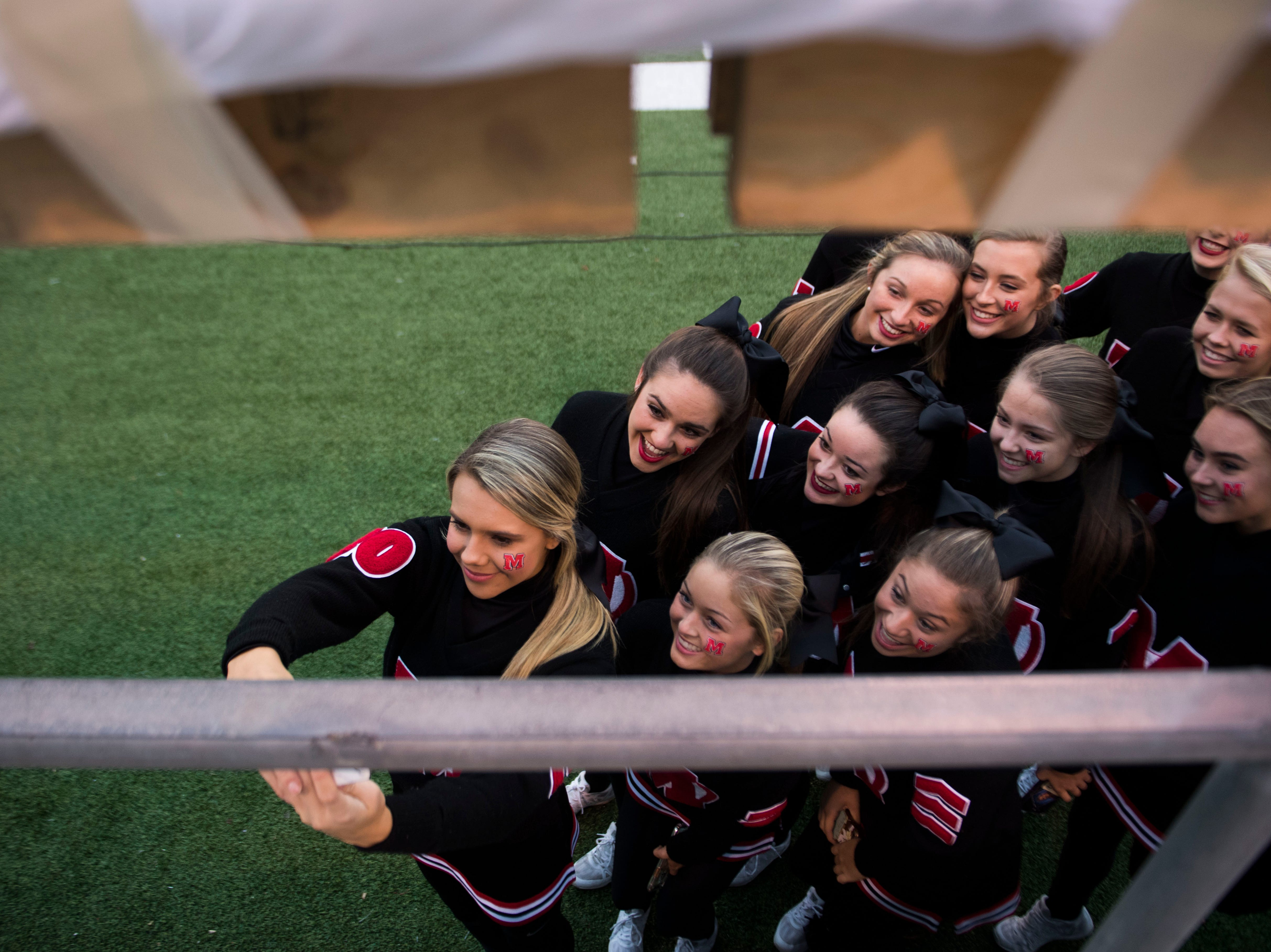 Maryville cheerleaders take a photo before a first round playoff game between Maryville and Bearden at Maryville, Friday, Nov. 2, 2018.