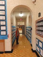 Old-style brick arches are found throughout Bearden Elementary, including by the hallway leading from gym.