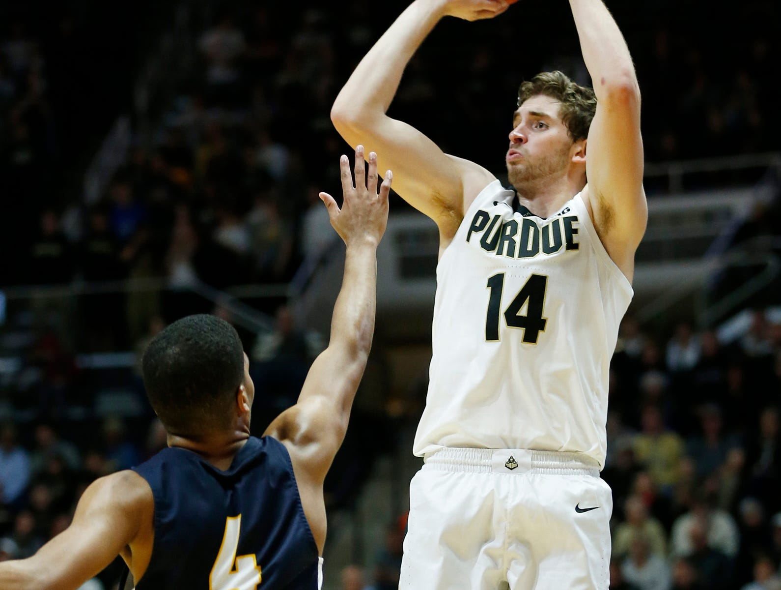 Ryan Cline of Purdue drains a three-point shot over West Stowers of Marian University Thursday, November 1, 2018, at Mackey Arena. Purdue defeated Marian University 75-56.